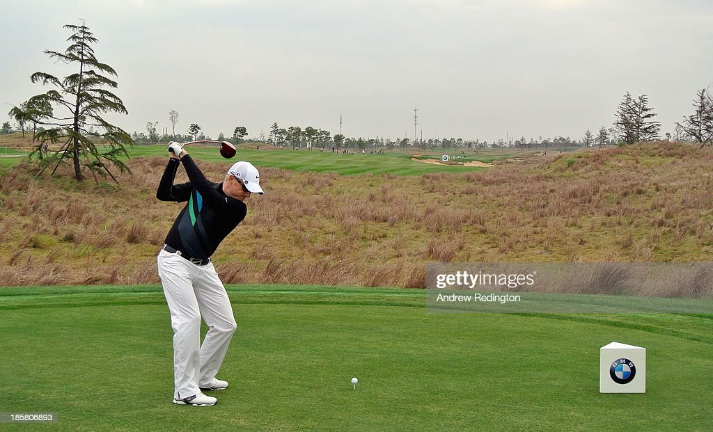 Simon Dyson of England hits his tee-shot on the 15th hole during the second round of the BMW Masters at Lake Malaren Golf Club on October 25, 2013 in Shanghai, China.