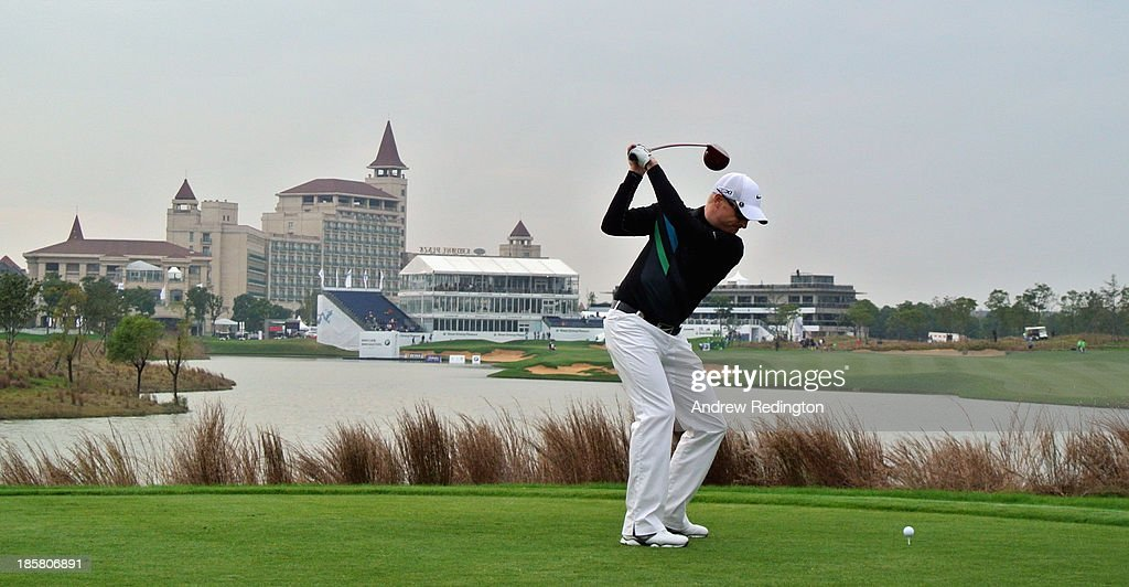 Simon Dyson of England hits his tee-shot on the 18th hole during the second round of the BMW Masters at Lake Malaren Golf Club on October 25, 2013 in Shanghai, China.