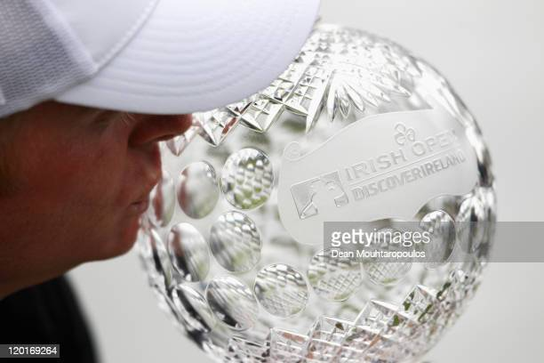Simon Dyson of England kisses the trophy after winning the Discover Ireland Irish Open held at Killarney Golf and Fishing Club on July 31 2011 in...