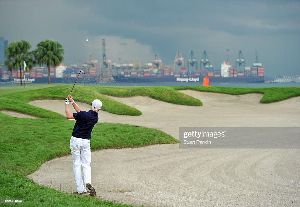 <a gi-track='captionPersonalityLinkClicked' href=/galleries/search?phrase=Simon+Dyson&family=editorial&specificpeople=214775 ng-click='$event.stopPropagation()'>Simon Dyson</a> of England plays a bunker shot during the second round of the Barclays Singapore Open at the Sentosa Golf Club on November 9, 2012 in Singapore.
