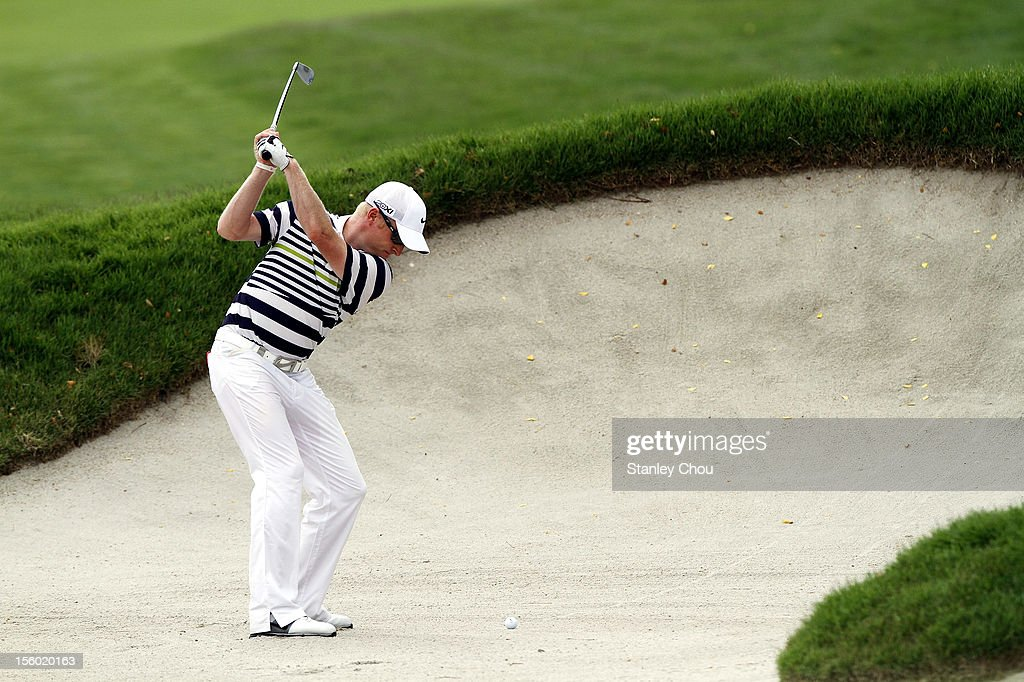 <a gi-track='captionPersonalityLinkClicked' href=/galleries/search?phrase=Simon+Dyson&family=editorial&specificpeople=214775 ng-click='$event.stopPropagation()'>Simon Dyson</a> of England plays a bunker shot on the 12th during the fourth round of the Barclays Singapore Open at the Sentosa Golf Club on November 11, 2012 in Singapore.