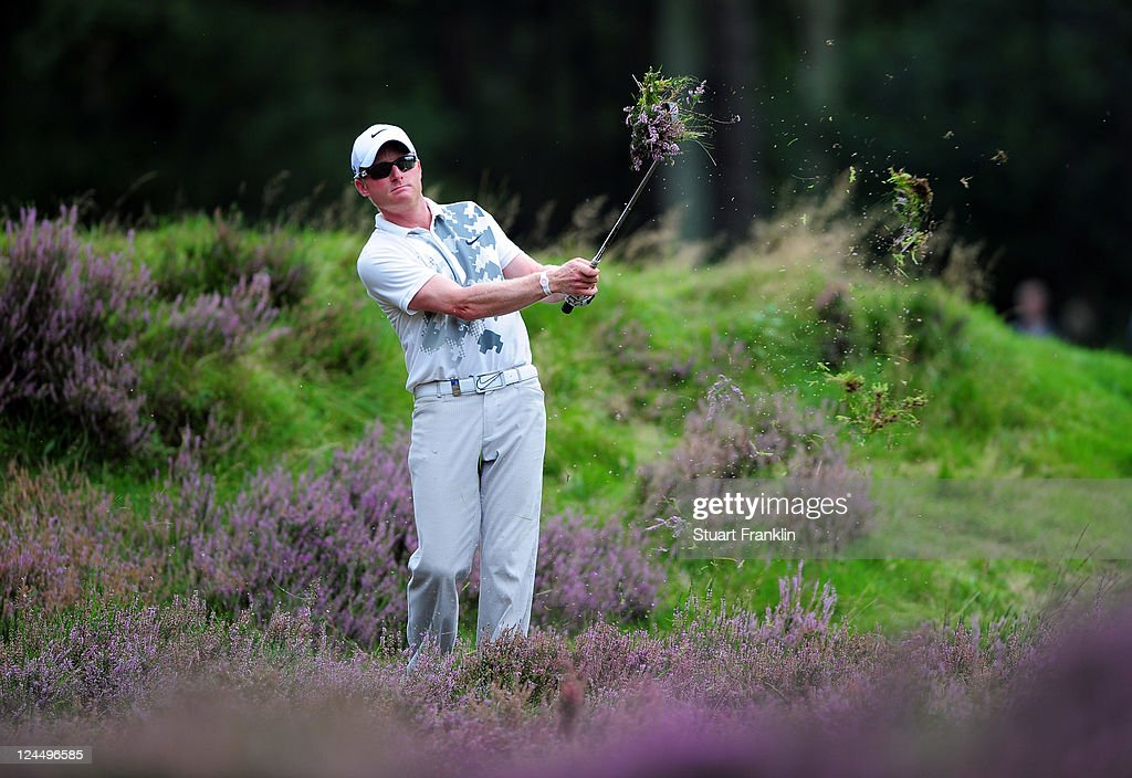 <a gi-track='captionPersonalityLinkClicked' href=/galleries/search?phrase=Simon+Dyson&family=editorial&specificpeople=214775 ng-click='$event.stopPropagation()'>Simon Dyson</a> of England plays his approach shot on the 11th hole during the third round of The KLM Open Golf at The Hillversumsche Golf Club on September 10, 2011 in Hilversum, Netherlands.