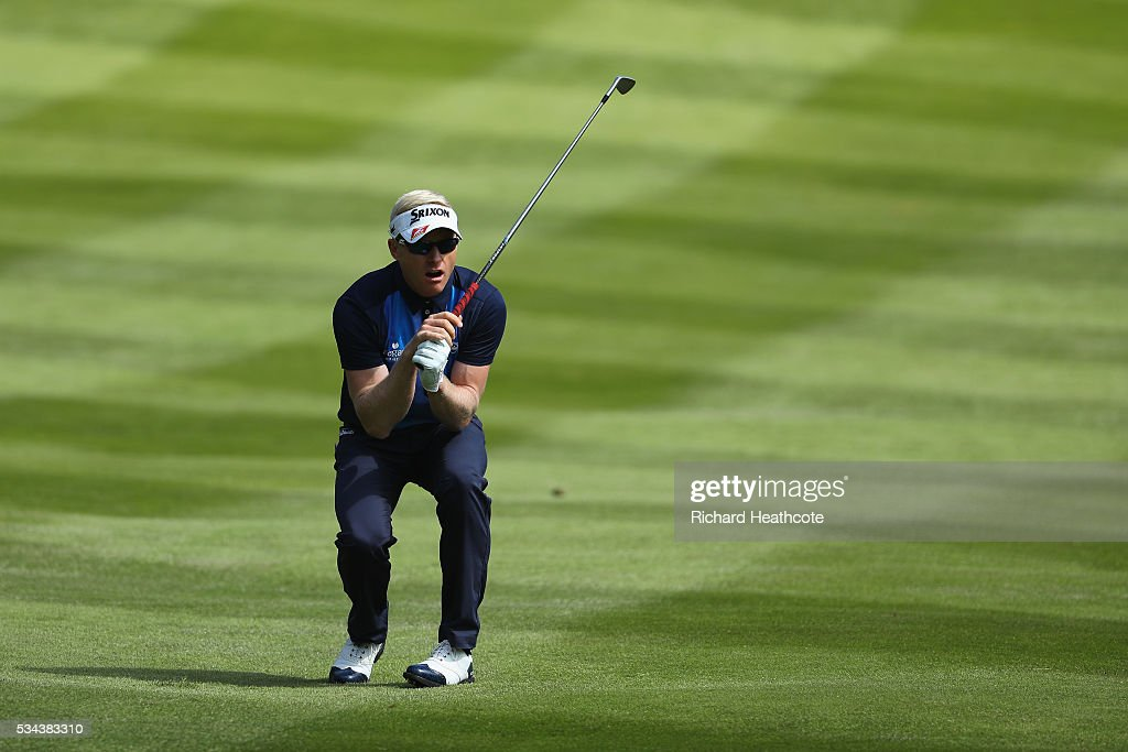 <a gi-track='captionPersonalityLinkClicked' href=/galleries/search?phrase=Simon+Dyson&family=editorial&specificpeople=214775 ng-click='$event.stopPropagation()'>Simon Dyson</a> of England watches his 2nd shot on the 4th hole during day one of the BMW PGA Championship at Wentworth on May 26, 2016 in Virginia Water, England.