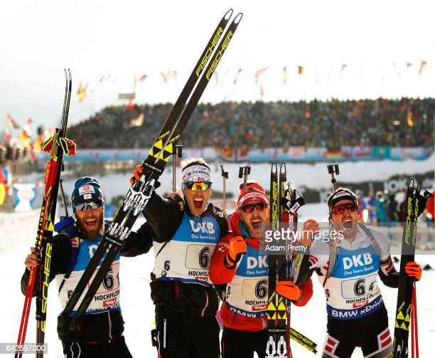Simon Eder Daniel Mesotitsch Julian Eberhard and Dominik Landertinger celebrate winning the Bronze medal after the Men's 4x 75km relay competition of...
