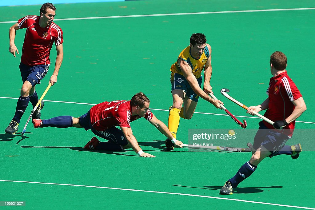 Simon Egerton of England tackles Glenn Simpson of the Kookaburras in the gold medal match between the Australian Kookaburras and England during day four of the 2012 International Super Series at Perth Hockey Stadium on November 25, 2012 in Perth, Australia.
