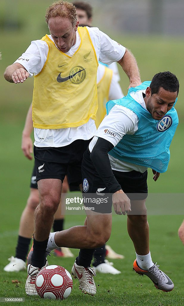 Simon Elliott competes with Leo Bertos for the ball during a New Zealand All Whites training session at North Harbour Stadium on May 20, 2010 in Auckland, New Zealand.