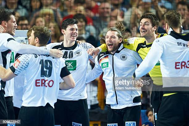 Simon Ernst and Johannes Sellin and goalkeeper Carsten Lichtlein all from Germany and their team mates celebrates after victory during the Men's EHF...