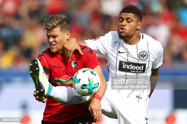 Simon Falette of Frankfurt and Florian Niederlechner of FC Freiburg during the Bundesliga match between SportClub Freiburg and Eintracht Frankfurt at...