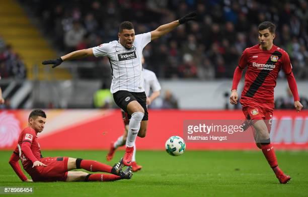 Simon Falette of Frankfurt is challenged by Lucas Alario of Leverkusen during the Bundesliga match between Eintracht Frankfurt and Bayer 04...
