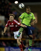 Simon Ferry of Swindon Town and Gabreil Agbonlahor of Aston Villa compete for the ball in the air during the Capital One Cup Fourth Round match...