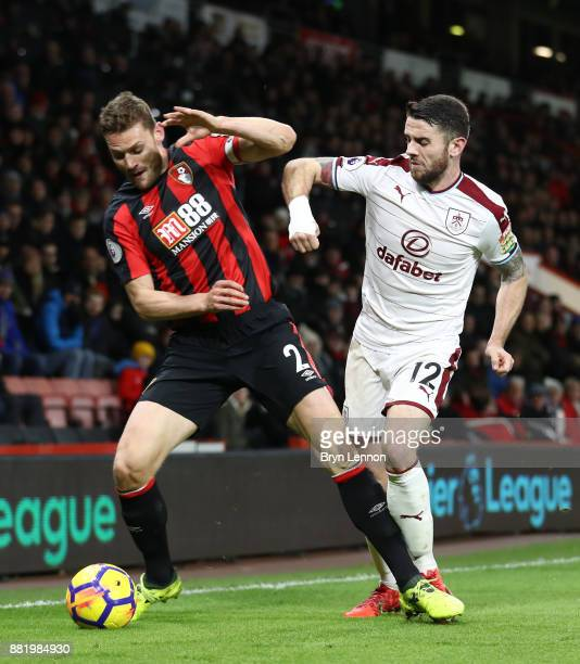 Simon Francis of AFC Bornemouth is challenged by Robbie Brady of Burnley during the Premier League match between AFC Bournemouth and Burnley at...