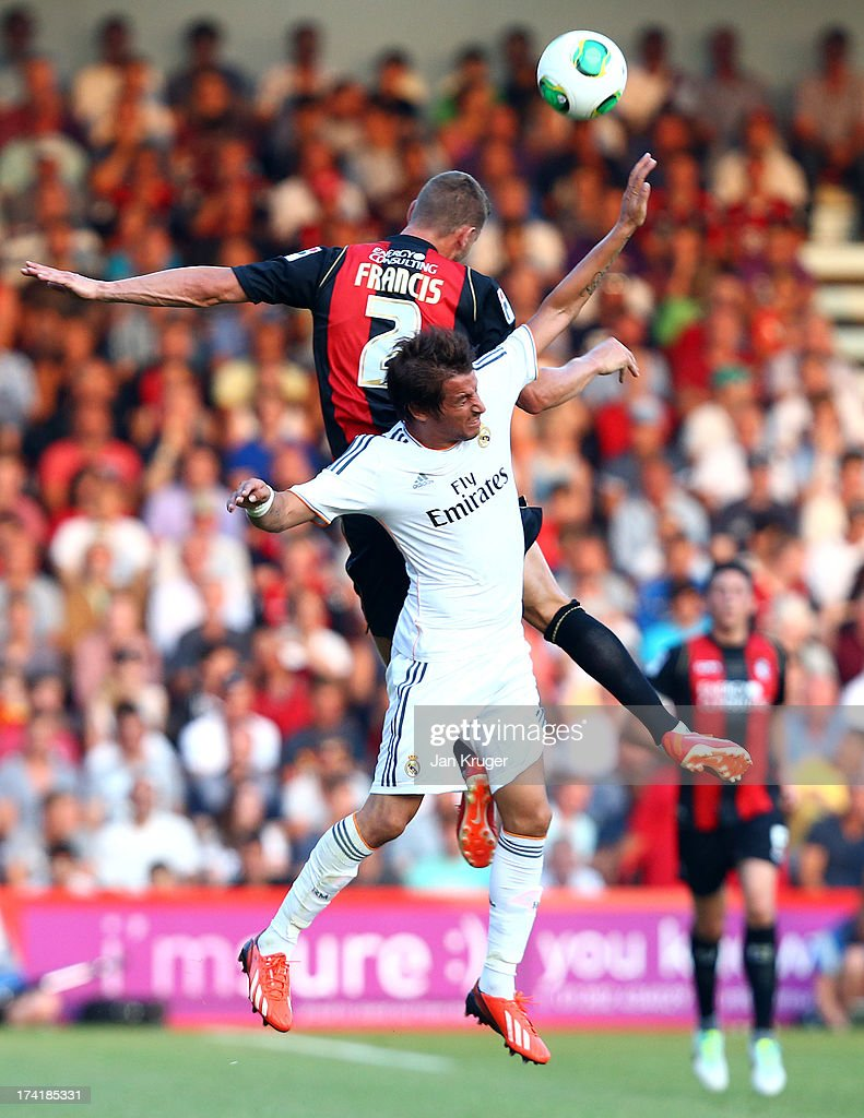 Simon Francis of AFC Bournemouth battles in the air with Fabio Coentrao of Real Madrid during a pre season friendly match between AFC Bournemouth and Real Madrid at Goldsands Stadium on July 21, 2013 in Bournemouth, England.