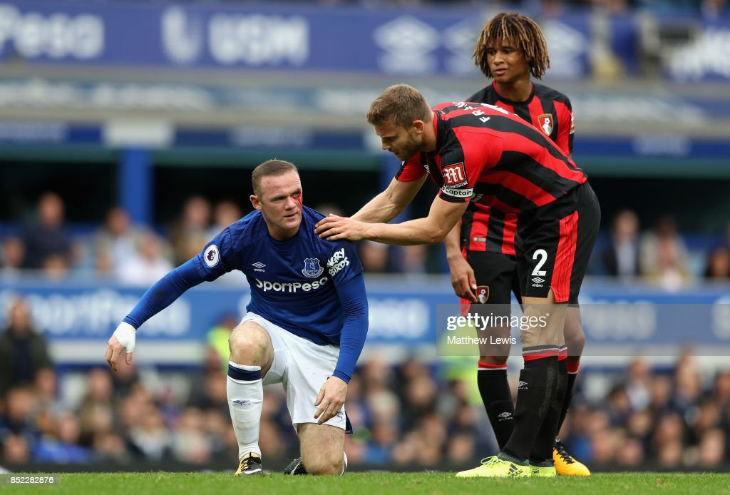 Simon Francis of AFC Bournemouth checks if Wayne Rooney of Everton is okay during the Premier League match between Everton and AFC Bournemouth at Goodison Park on September 23, 2017 in Liverpool, England.