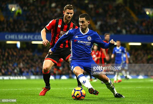 Simon Francis of AFC Bournemouth closes down Eden Hazard of Chelsea during the Premier League match between Chelsea and AFC Bournemouth at Stamford...
