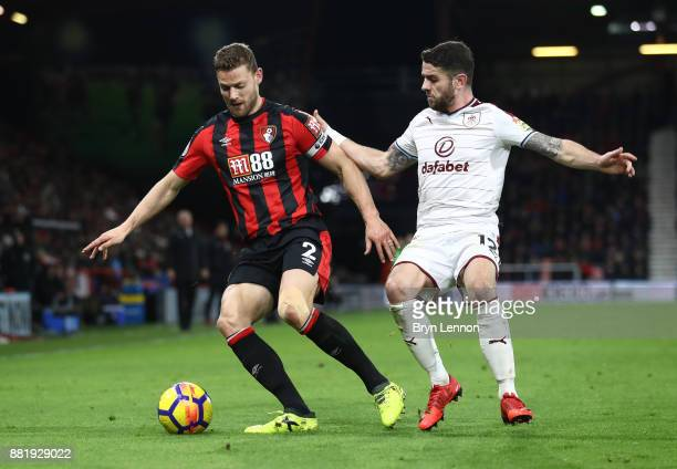 Simon Francis of AFC Bournemouth is challenged by Robbie Brady of Burnley during the Premier League match between AFC Bournemouth and Burnley at...