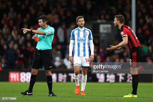 Simon Francis of AFC Bournemouth is shown a red card by referee Lee Probert during the Premier League match between AFC Bournemouth and Huddersfield...