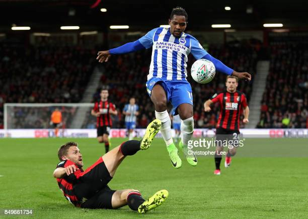 Simon Francis of AFC Bournemouth tackles Elvis Manu of Brighton and Hove Albion during the Carabao Cup Third Round match between AFC Bournemouth and...