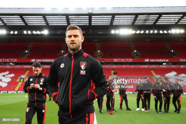 Simon Francis of AFC Bournemouth takes a look around the pitch prior to the Premier League match between Liverpool and AFC Bournemouth at Anfield on...
