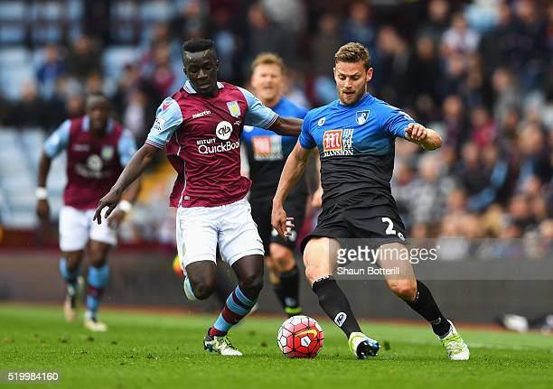 Simon Francis of Bournemouth and Idrissa Gueye of Aston Villa compete for the ball during the Barclays Premier League match between Aston Villa and...