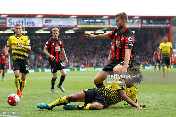 Simon Francis of Bournemouth and Nathan Ake of Watford compete for the ball during the Barclays Premier League match between AFC Bournemouth and...