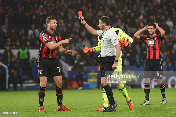 Simon Francis of Bournemouth is shown a red card by referee Andre Marriner after fouling on Jamie Vardy of Leicester City during the Barclays Premier...