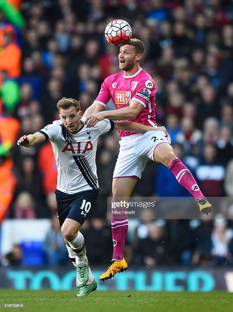 Simon Francis of Bournemouth outjumps Harry Kane of Tottenham Hotspur during the Barclays Premier League match between Tottenham Hotspur and A.F.C. Bournemouth at White Hart Lane on March 20, 2016 in London, United Kingdom.