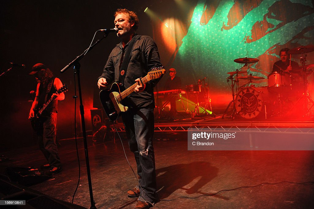 Simon Friend, Mark Chadwick, Matt Savage and Charlie Heather of The Levellers perform on stage at O2 Shepherd's Bush Empire on November 24, 2012 in London, England.
