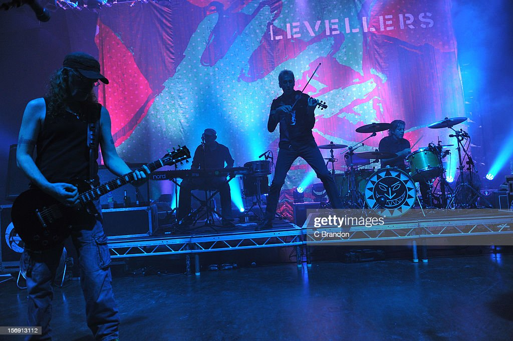 Simon Friend, Matt Savage, Jonathan Sevink and Charlie Heather of The Levellers perform on stage at O2 Shepherd's Bush Empire on November 24, 2012 in London, England.