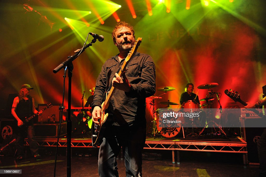Simon Friend, Matt Savage, Mark Chadwick and Charlie Heather of The Levellers perform on stage at O2 Shepherd's Bush Empire on November 24, 2012 in London, England.