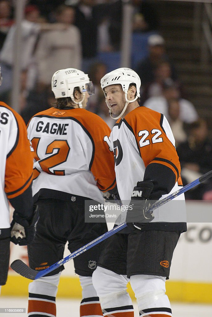 Simon Gagne #12 and Mike Knuble #22 of the Philadelphia Flyers celebrate after a goal during game two playoffs action versus the Buffalo Sabres at the HSBC Arena in Buffalo, NY, April 24, 2006. Buffalo defeated Philadelphia 8 -2 .
