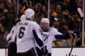 Simon Gagne celebrates his first period goal with Steven Stamkos and Ryan Malone of the Tampa Bay Lightning in Game Five of the Eastern Conference...