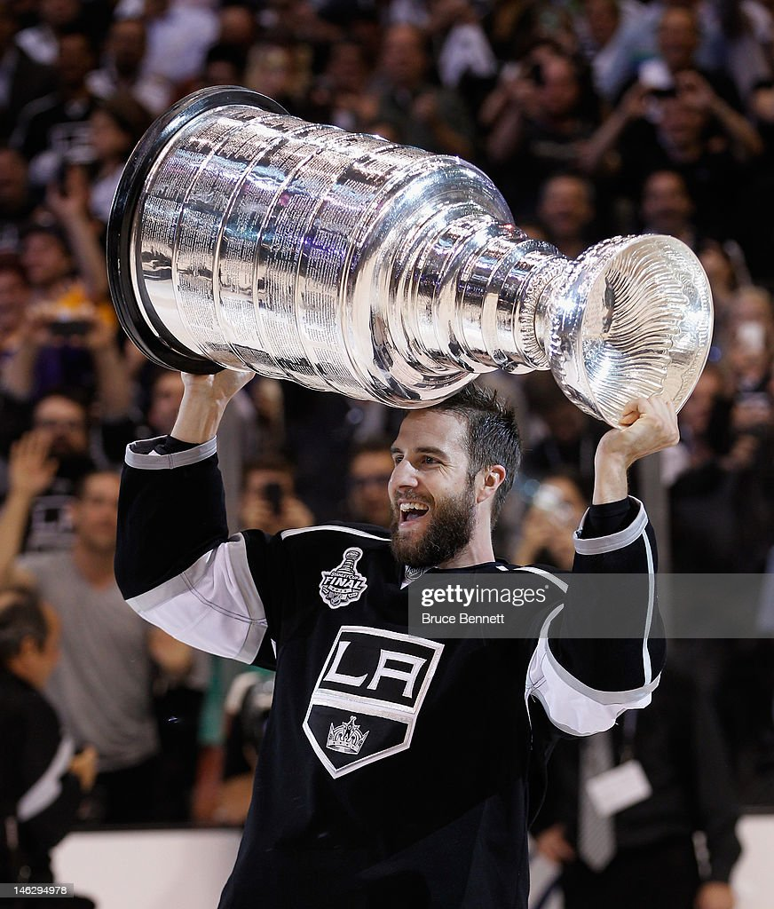 <a gi-track='captionPersonalityLinkClicked' href=/galleries/search?phrase=Simon+Gagne&family=editorial&specificpeople=201772 ng-click='$event.stopPropagation()'>Simon Gagne</a> #12 of the Los Angeles Kings holds up the Stanley Cup after the Kings defeated the New Jersey Devils 6-1 to win the Stanley Cup series 4-2 in Game Six of the 2012 Stanley Cup Final at Staples Center on June 11, 2012 in Los Angeles, California.