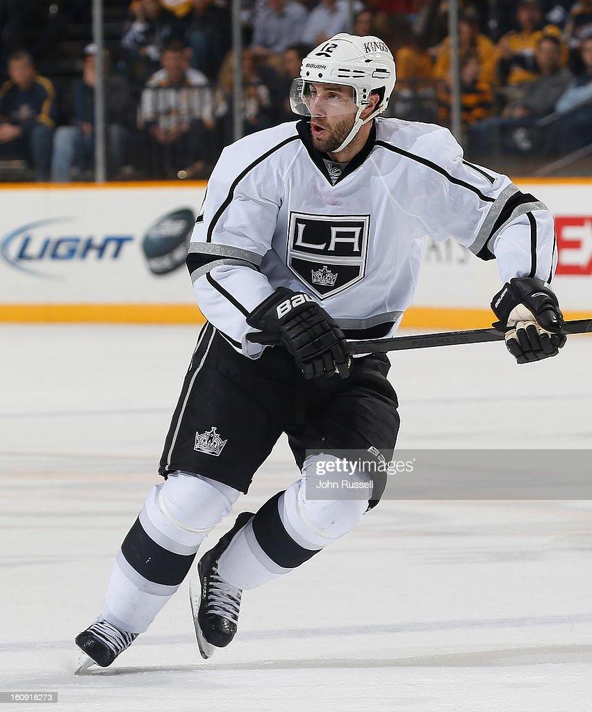 <a gi-track='captionPersonalityLinkClicked' href=/galleries/search?phrase=Simon+Gagne&family=editorial&specificpeople=201772 ng-click='$event.stopPropagation()'>Simon Gagne</a> #12 of the Los Angeles Kings skates against the Nashville Predators during an NHL game at the Bridgestone Arena on February 7, 2013 in Nashville, Tennessee.