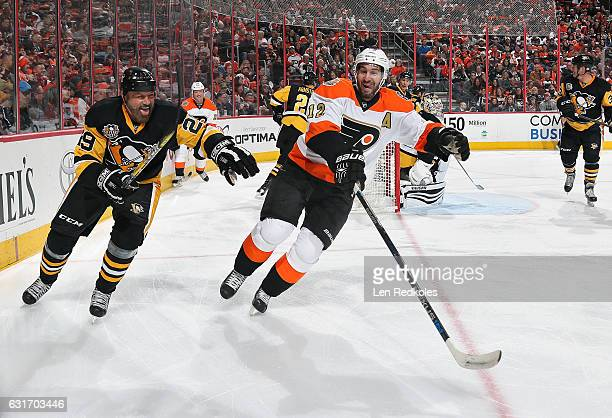 Simon Gagne of the Philadelphia Flyers Alumni skates in the corner against Phil Bourque of the Pittsburgh Penguins Alumni on January 14 2017 at the...