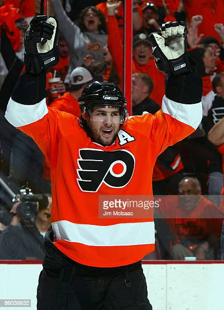 Simon Gagne of the Philadelphia Flyers celebrates his second period goal against the Pittsburgh Penguins during Game Three of the Eastern Conference...