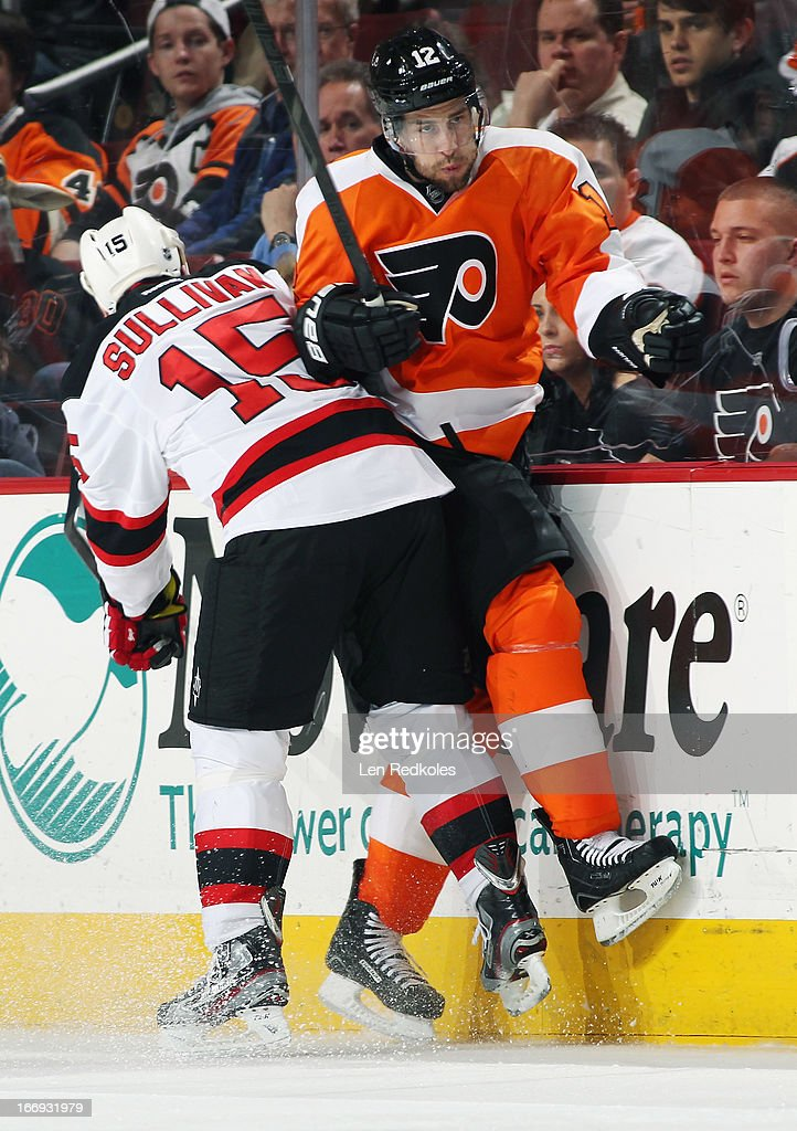 <a gi-track='captionPersonalityLinkClicked' href=/galleries/search?phrase=Simon+Gagne&family=editorial&specificpeople=201772 ng-click='$event.stopPropagation()'>Simon Gagne</a> #12 of the Philadelphia Flyers is checked into the boards by <a gi-track='captionPersonalityLinkClicked' href=/galleries/search?phrase=Steve+Sullivan&family=editorial&specificpeople=201723 ng-click='$event.stopPropagation()'>Steve Sullivan</a> #15 of the New Jersey Devils on April 18, 2013 at the Wells Fargo Center in Philadelphia, Pennsylvania. The Devils went on to defeat the Flyers 3-0.