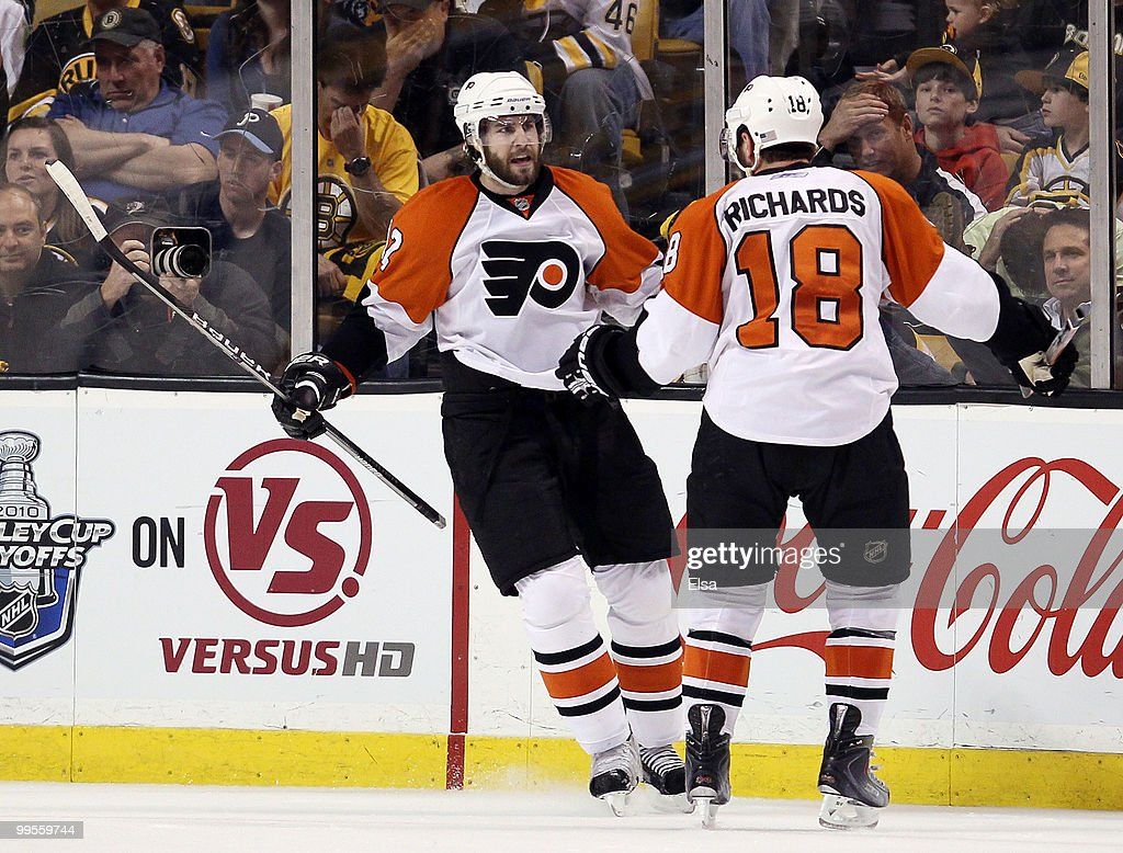 Simon Gagne #12 of the Philadelphia Flyers is congratulated by teammate Mike Richards #18 after Gagne scored the game winner on a power play in the third period against the Boston Bruins in Game Seven of the Eastern Conference Semifinals during the 2010 NHL Stanley Cup Playoffs at TD Garden on May 14, 2010 in Boston, Massachusetts. The Flyers defeated the Bruins 4-3.