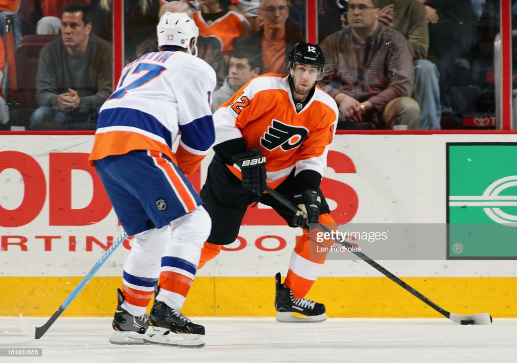 <a gi-track='captionPersonalityLinkClicked' href=/galleries/search?phrase=Simon+Gagne&family=editorial&specificpeople=201772 ng-click='$event.stopPropagation()'>Simon Gagne</a> #12 of the Philadelphia Flyers looks to make a pass while being defended by Matt Martin #17 of the New York Islanders on March 28, 2013 at the Wells Fargo Center in Philadelphia, Pennsylvania.