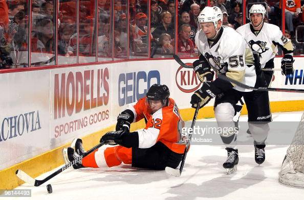 Simon Gagne of the Philadelphia Flyers plays the puck against Sergei Gonchar of the Pittsburgh Penguins on January 24 2010 at Wachovia Center in...