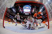 Simon Gagne of the Philadelphia Flyers scores a goal against Antti Niemi of the Chicago Blackhawks in the second period as Niklas Hjalmarsson and...