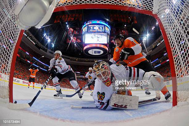 Simon Gagne of the Philadelphia Flyers scores a goal against Antti Niemi of the Chicago Blackhawks in the second period as Niklas Hjalmarsson of the...
