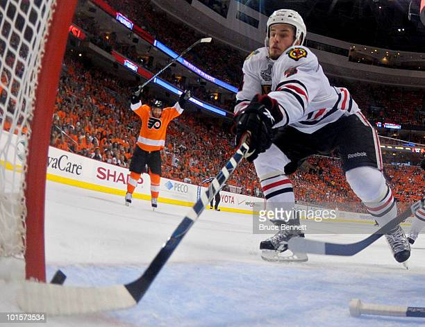 Simon Gagne of the Philadelphia Flyers scores a goal against Antti Niemi and Niklas Hjalmarsson of the Chicago Blackhawks in the second period in...
