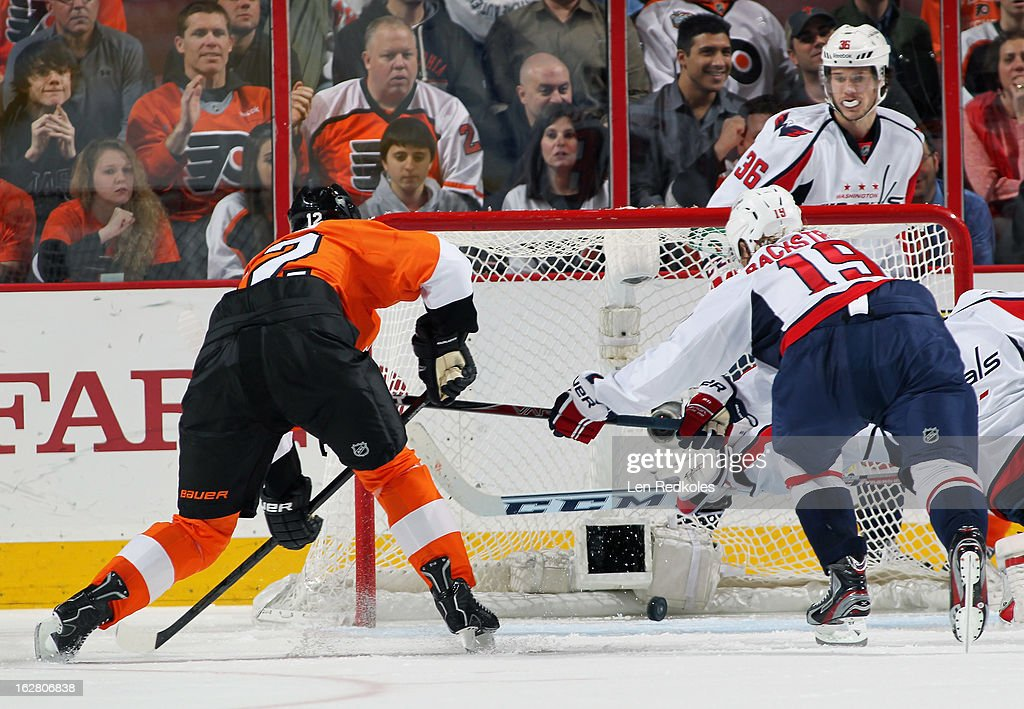 <a gi-track='captionPersonalityLinkClicked' href=/galleries/search?phrase=Simon+Gagne&family=editorial&specificpeople=201772 ng-click='$event.stopPropagation()'>Simon Gagne</a> #12 of the Philadelphia Flyers scores a second period power-play goal, his first after being aquired by the Flyers in a trade yesterday, against the Washington Capitals on February 27, 2013 at the Wells Fargo Center in Philadelphia, Pennsylvania.