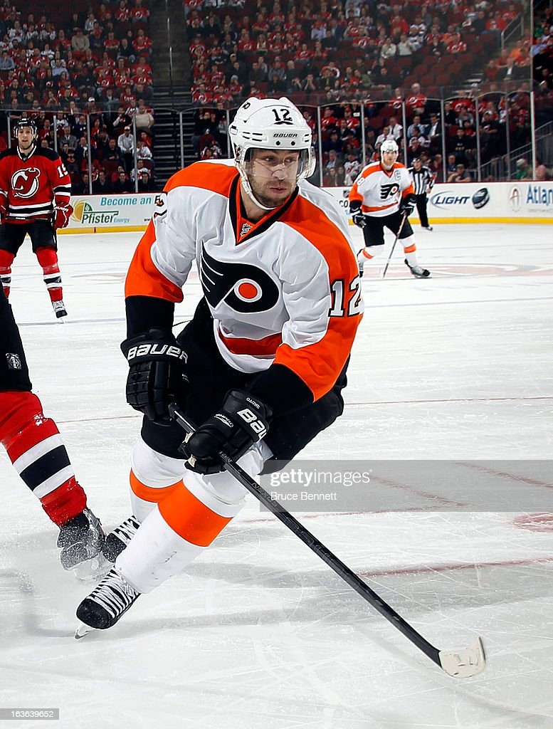 <a gi-track='captionPersonalityLinkClicked' href=/galleries/search?phrase=Simon+Gagne&family=editorial&specificpeople=201772 ng-click='$event.stopPropagation()'>Simon Gagne</a> #12 of the Philadelphia Flyers skates against the New Jersey Devils at the Prudential Center on March 13, 2013 in Newark, New Jersey. The Devils defeated the Flyers 5-2.