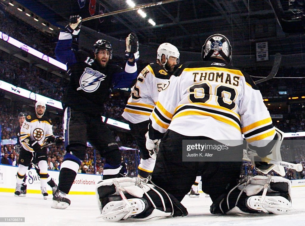 Simon Gagne #12 of the Tampa Bay Lightning celebrates a goal by Teddy Purcell #16 as Tim Thomas #30 of the Boston Bruins defends in Game Six of the Eastern Conference Finals during the 2011 NHL Stanley Cup Playoffs at St Pete Times Forum on May 25, 2011 in Tampa, Florida.