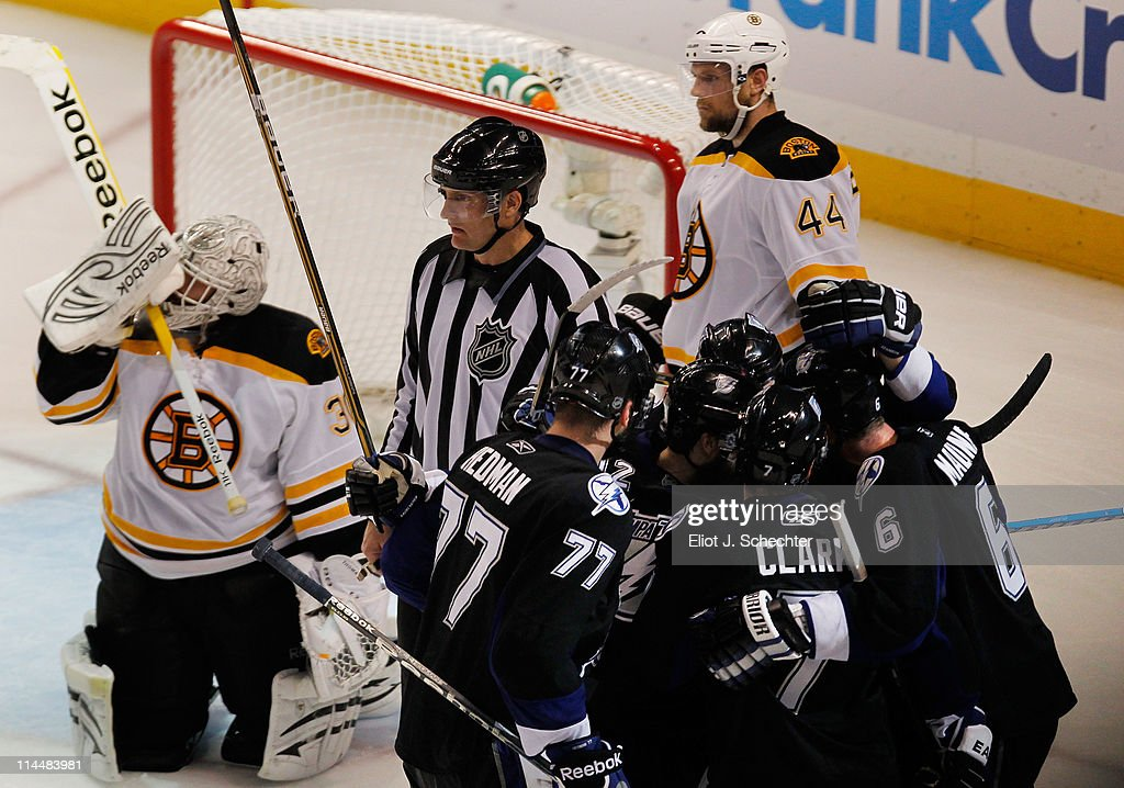 <a gi-track='captionPersonalityLinkClicked' href=/galleries/search?phrase=Simon+Gagne&family=editorial&specificpeople=201772 ng-click='$event.stopPropagation()'>Simon Gagne</a> #12 of the Tampa Bay Lightning celebrates scoring a third period goal with teammates as Tim Thomas #30 and <a gi-track='captionPersonalityLinkClicked' href=/galleries/search?phrase=Dennis+Seidenberg&family=editorial&specificpeople=204616 ng-click='$event.stopPropagation()'>Dennis Seidenberg</a> #44 of the Boston Bruins reacts in Game Four of the Eastern Conference Finals during the 2011 NHL Stanley Cup Playoffs at St Pete Times Forum on May 21, 2011 in Tampa, Florida.