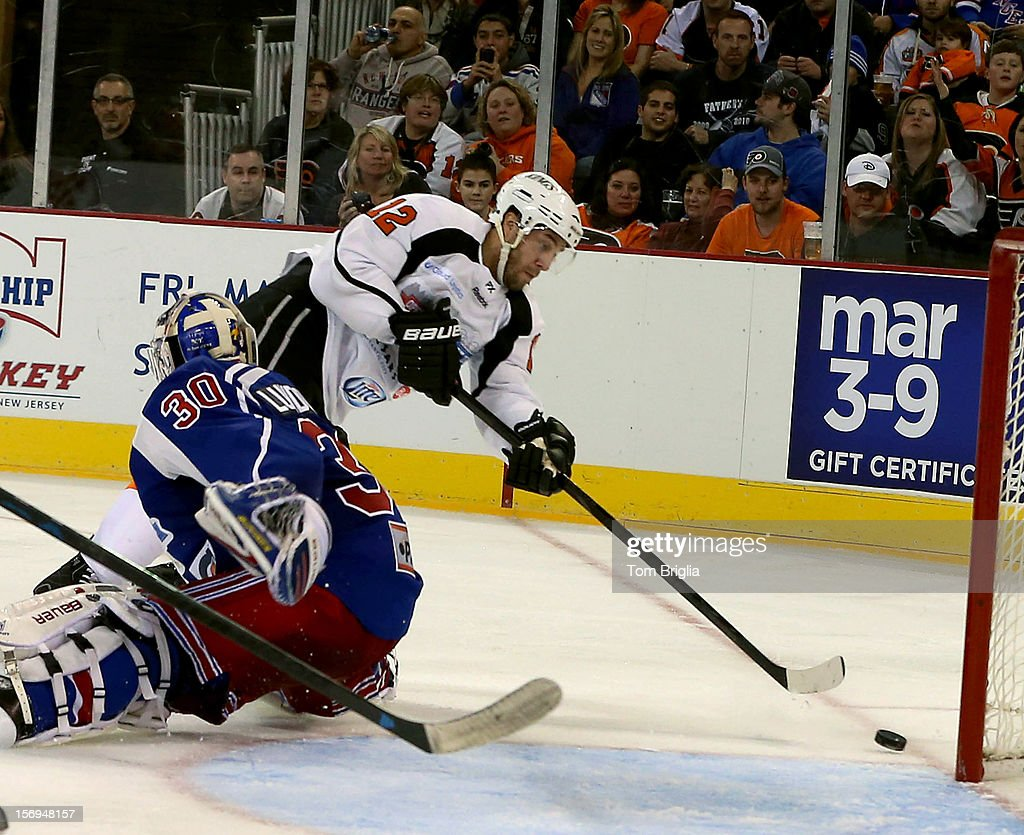<a gi-track='captionPersonalityLinkClicked' href=/galleries/search?phrase=Simon+Gagne&family=editorial&specificpeople=201772 ng-click='$event.stopPropagation()'>Simon Gagne</a> #12 takes a shot on goal during Operation Hat Trick Benefit Exhibition Hockey Game at Boardwalk Hall Arena on November 24, 2012 in Atlantic City, New Jersey.