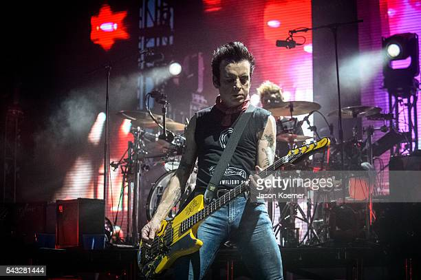 Simon Gallup of The Cure performs at Bayfront Park Amphitheater on June 26 2016 in Miami Florida