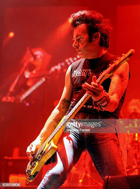 Simon Gallup of The Cure performs at Manchester Arena on November 29 2016 in Manchester United Kingdom