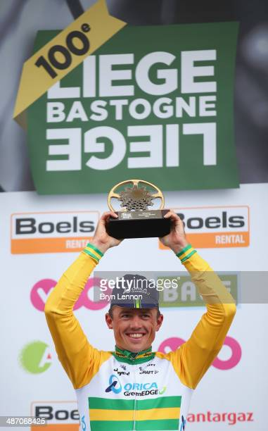 Simon Gerrans of Australia and Orica GreenEDGE celebrates on the podium after winning the 100th edition of the LiegeBastogneLiege road race on April...